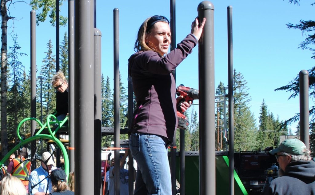 Jackie Jaworenko came from Priddis to help build the playground. One of her children attends Banded Peak School. Photo: Enrique Massot